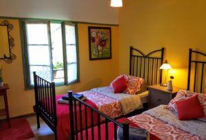 Pretty double aspect twin bedroom